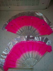 Pink and silver fans with gems.